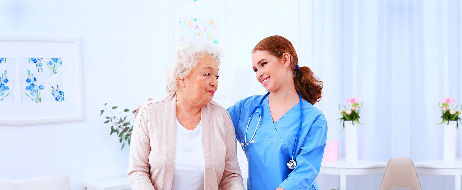 elder woman with nurse hugging her