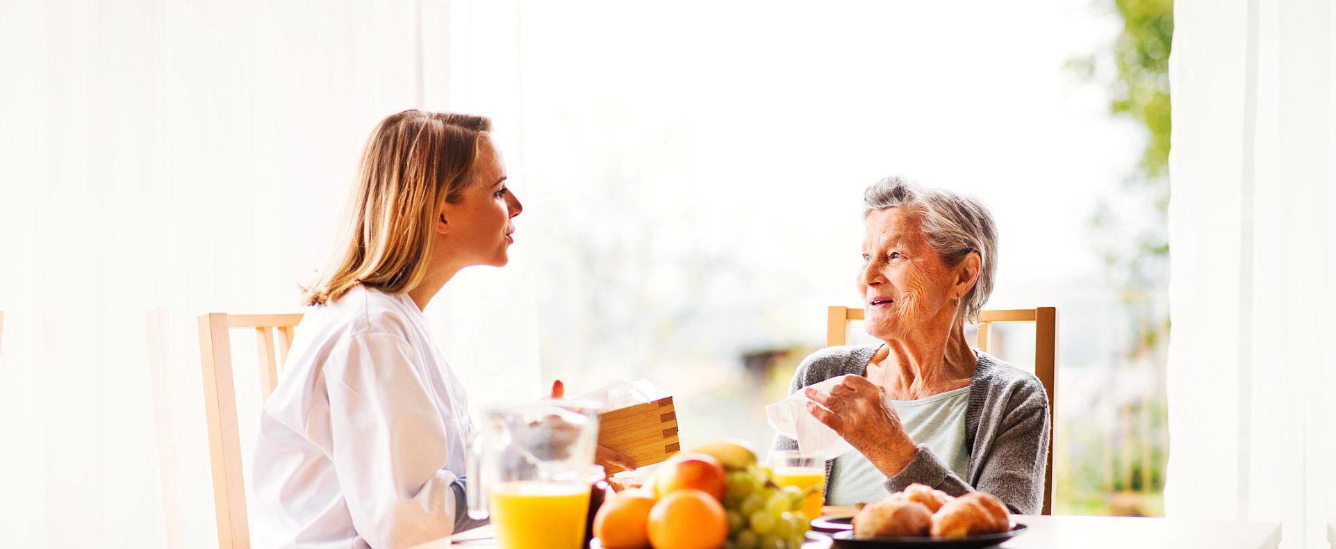 elder woman and caregiver talking