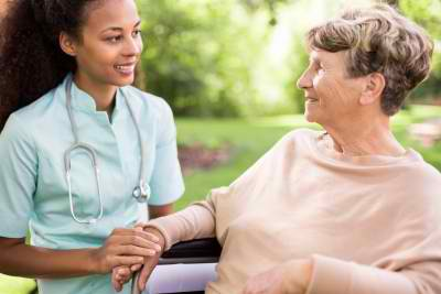 senior woman and doctor spending time in the garden
