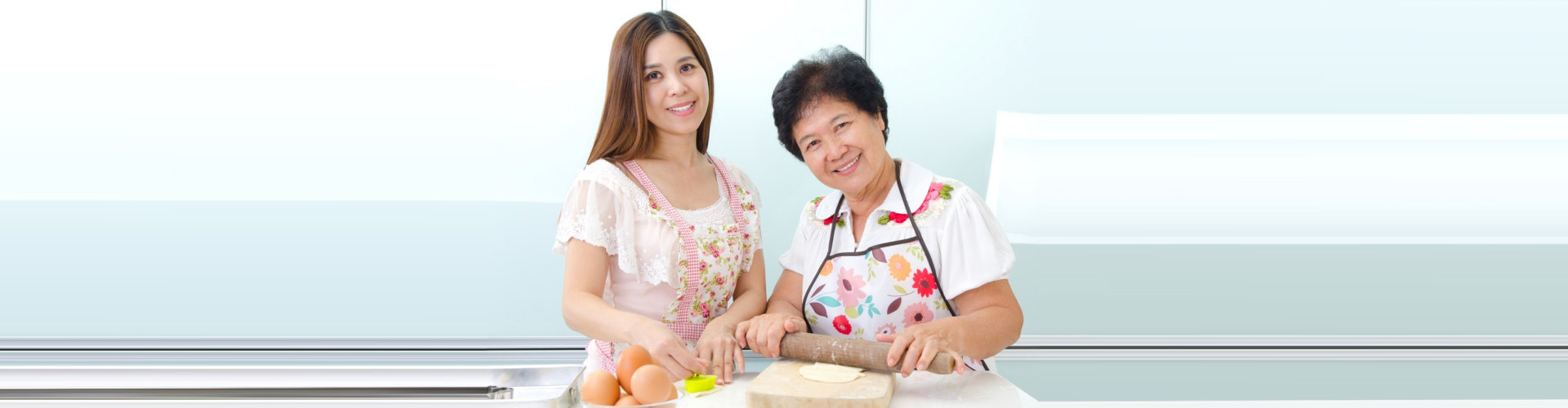 elder woman with caregiver preparing foods